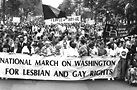 The 1987 National March on Washington for Lesbian and Gay Rights. Among those in the front are Eleanor Smeal, Pat Parker, Karen Thompson, Kate Clinton, Gil Gerald and Whoopi Goldberg pushing a person living with AIDS in a wheelchair. Photo by M.J. Murphy