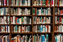 Gerber-Hart-holding-large-book-sale-exhibit-viewing-June-6